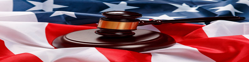 Gavel on top of the USA flag.