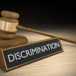 "Gavel next to the word ""Discrimination."""