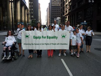 EFE staff holding a banner at the Chicago Disability Pride Parade.