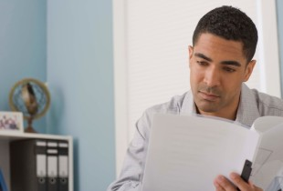 Man reading paper documents