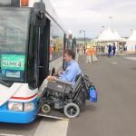 Man in a wheelchair boarding a bus