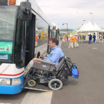 Man in a wheelchair boarding a bus