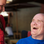 Man with developmental disability laughing with woman