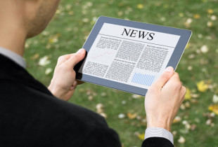 Man reading news on a tablet PC