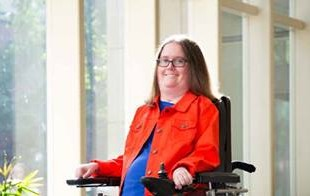 Photo of Rebecca Wylie, an EFE intern who uses a wheelchair