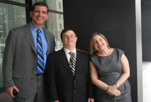 Photo of EFE client, Stanley Ligas after a Fairness Hearing, standing with EFE staff, Barry Taylor and Laura Miller