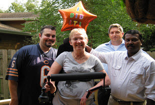 EFE Client, Sue Peterson, celebrating her new standup wheelchair.