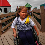 girl in wheelchair on accessible playground
