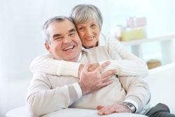 A senior citizens hugging