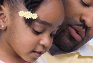 Man teaching young girl