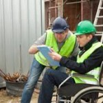 Man in wheelchair working at construction site