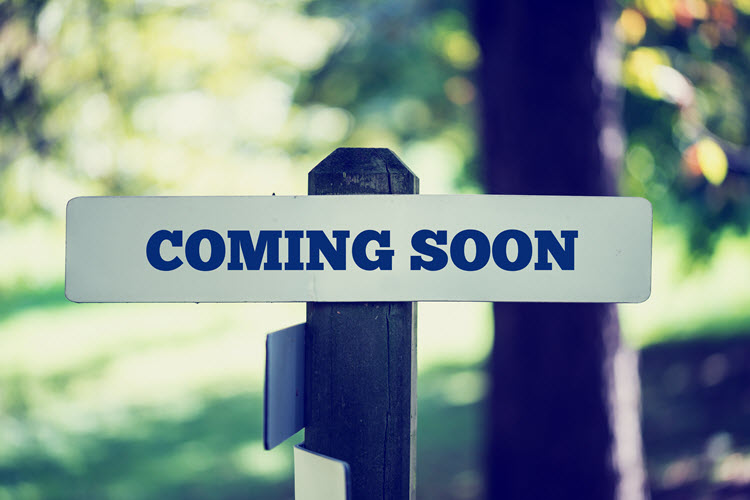 "The words, ""coming soon"" nailed to a post outside."