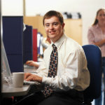 Man sitting in cubicle