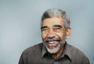 Elderly man smiling.