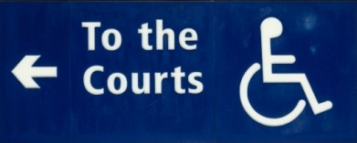 "Accessibility sign that has an arrow and ""To the Courts"""