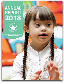 Cover of Annual Report featuring girl with down syndrome